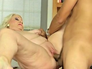 Busty GILF Teacher Takes A Young Dick After Class